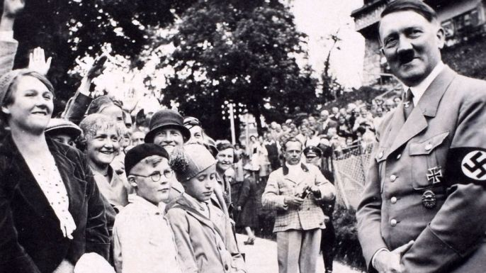 German Führer Adolf Hitler greets the elated masses at a wartime rally. 1939.