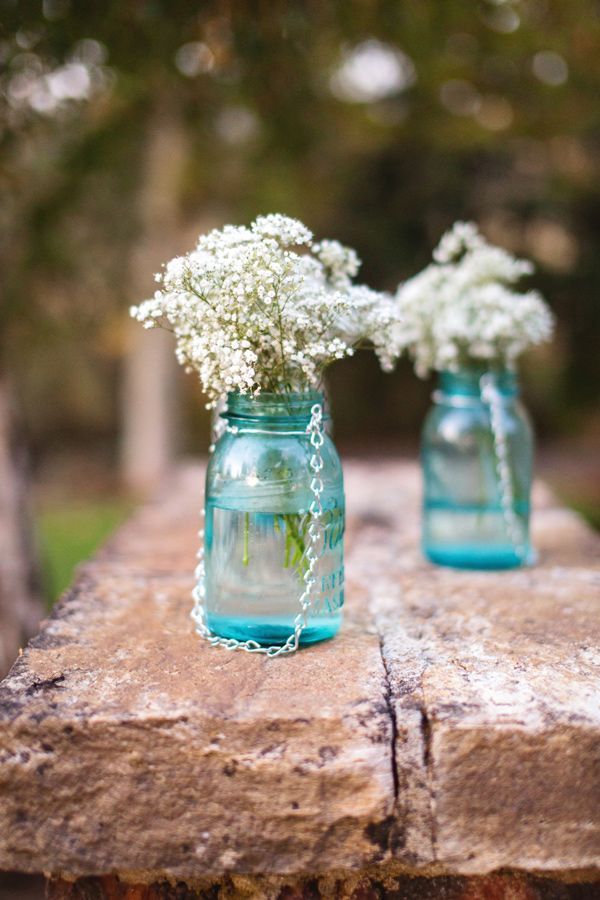 Rustic mason jar floral centerpieces.