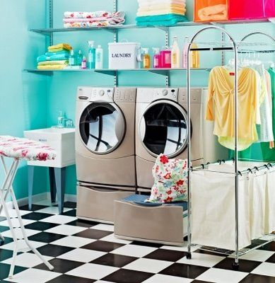 I dream of an organized laundry room! Aqua walls and the black & white floor...awesome!
