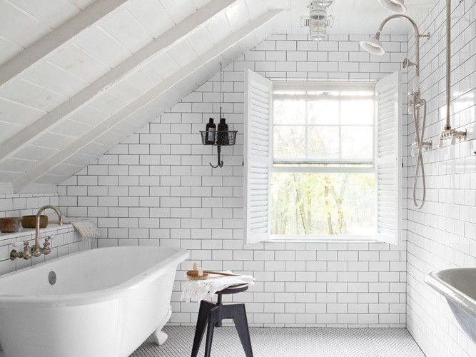 Bathroom - Attic space, the entire room is tiled and functions as a shower. Now... how to get a clawfoot tub into my fourth-story attic...