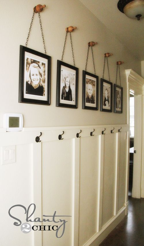 LOVE LOVE LOVE this DIY Wall Art w/chains....Plus, I just love this whole thing.  The hooks below the pictures are perfect!