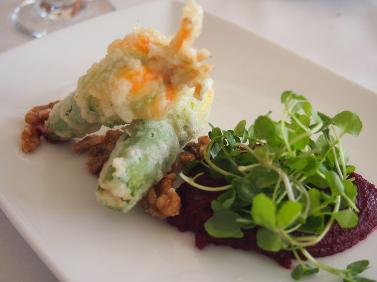 Zucchini Flowers stuffed with ricotta and brie with beetroot tapanade, candied walnuts, watercress.