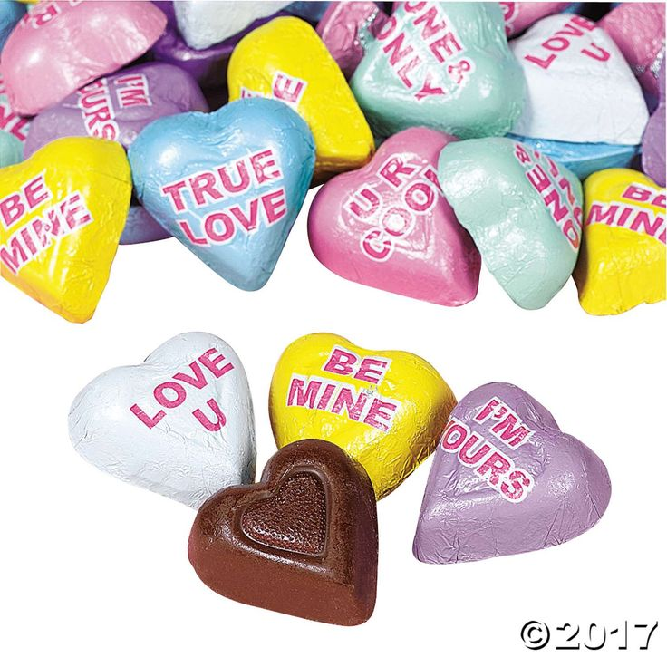 Say it with chocolate!. Each foil wrapper on these heart-shaped valentine candy chocolates has a special message for your sweetie. Add to your Valentine's ...