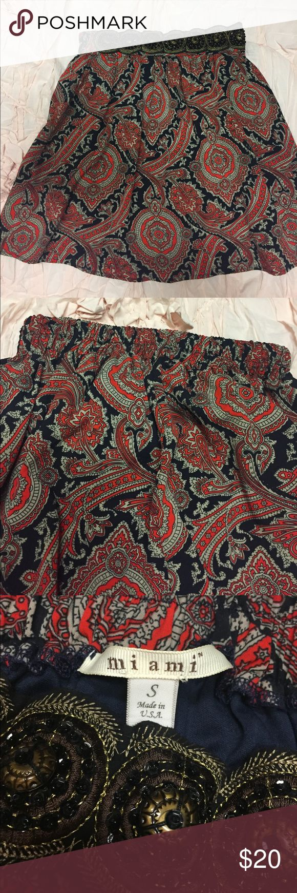 Small Boutique Brand Skirt Only worn once and in excellent shape! This skirt is a size small and includes a comfortable elastic waistband. The gold, black, and red patterned fabric is perfect for fall! This beaded detail on the waistband is beautiful! Miami brand purchased at Francesca's! miami Skirts Mini