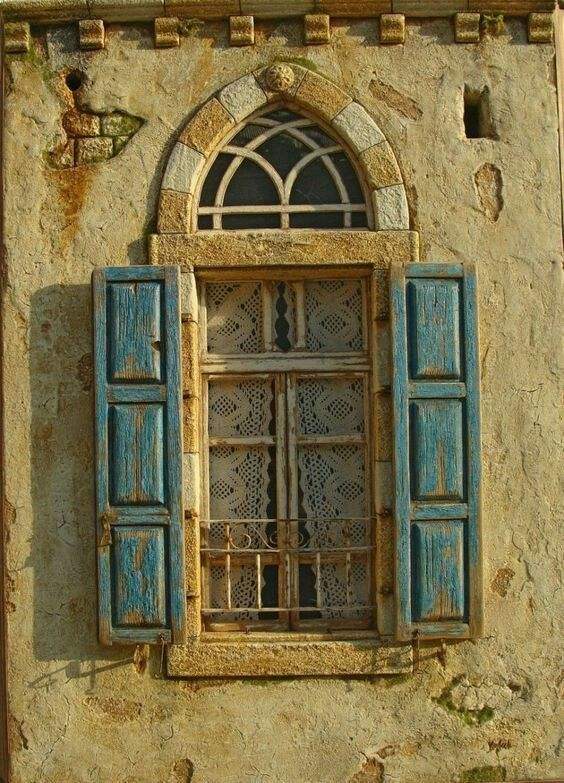 Lovely arched window & shutters