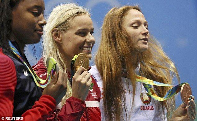 After Blume, Simone Manuel (left) was second and Aliaksandra Herasimenia (right)…