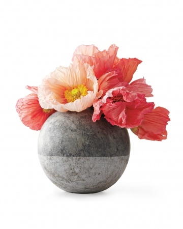 """Flower Mix  """"A bouquet often leaves a hostess scrambling to trim stems and find a vase. Instead, I bring a casual mix of flowers arranged in a pretty vessel."""" -- Jessica Romm, lifestyle editor   Brazilian hand-cut soapstone vase, $55, rubybeets.com."""