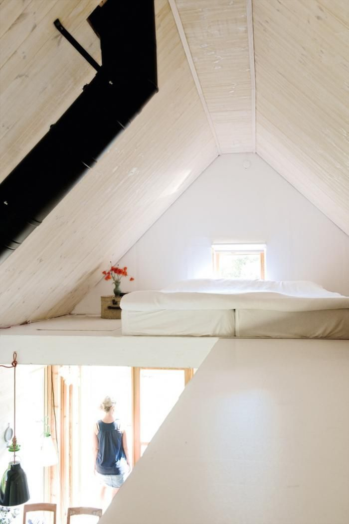 A loft bedroom in a Gotland summer house, via My Scandinavian Retreat.