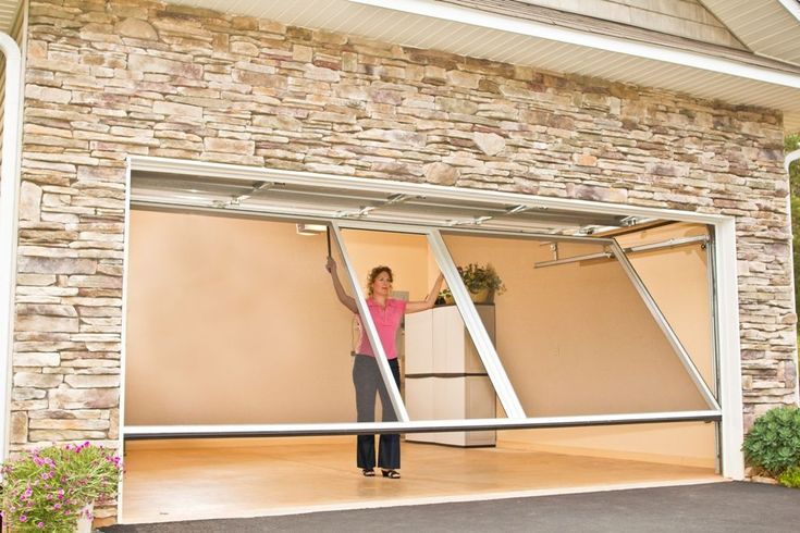 The Lifestyle Garage Screen is easy to open and close because it has it's own track and springs so it operates independently of your garage door! www.daytondoors.com