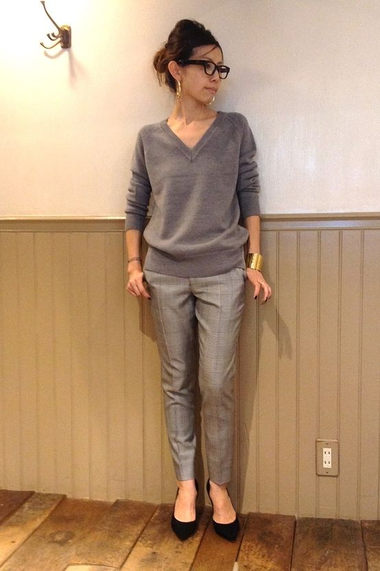Black mocha shirt with charcoal pants/ silver pants or grey pants with appropriate jewellry.