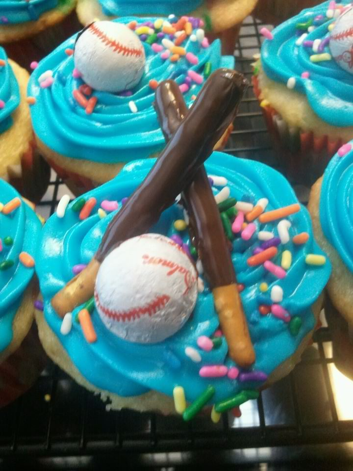 Cupcakes me and my mom made for my cousins softball team.