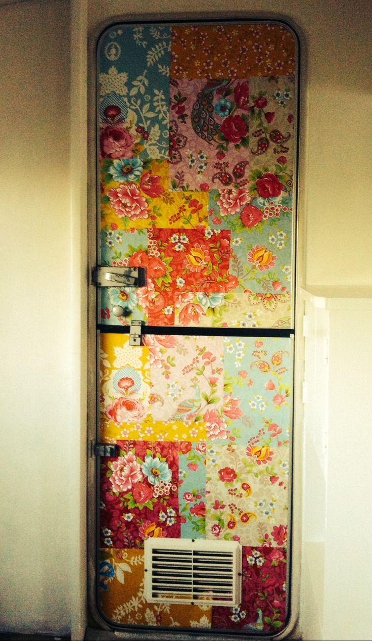 Patchwork of wallpaper samples from Pip Studios on inside of caravan door.