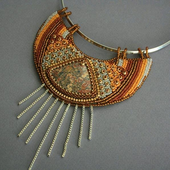 Bead embroidered bib necklace  by Polish maker Elena Orłowska. Seed beads, stone cabochon, chain fringe, metal necklet.