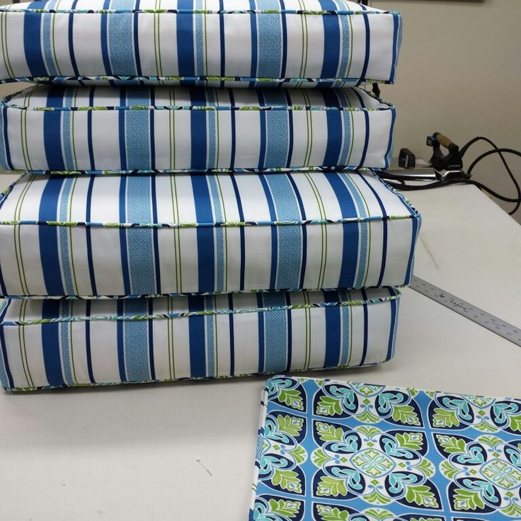 Outdoor cushions with coordinating toss cushions