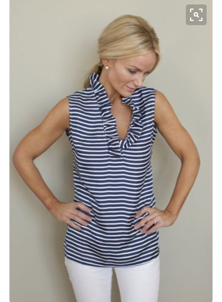 Love the stripes mixed with the pretty ruffled neckline.  Gorgeous!