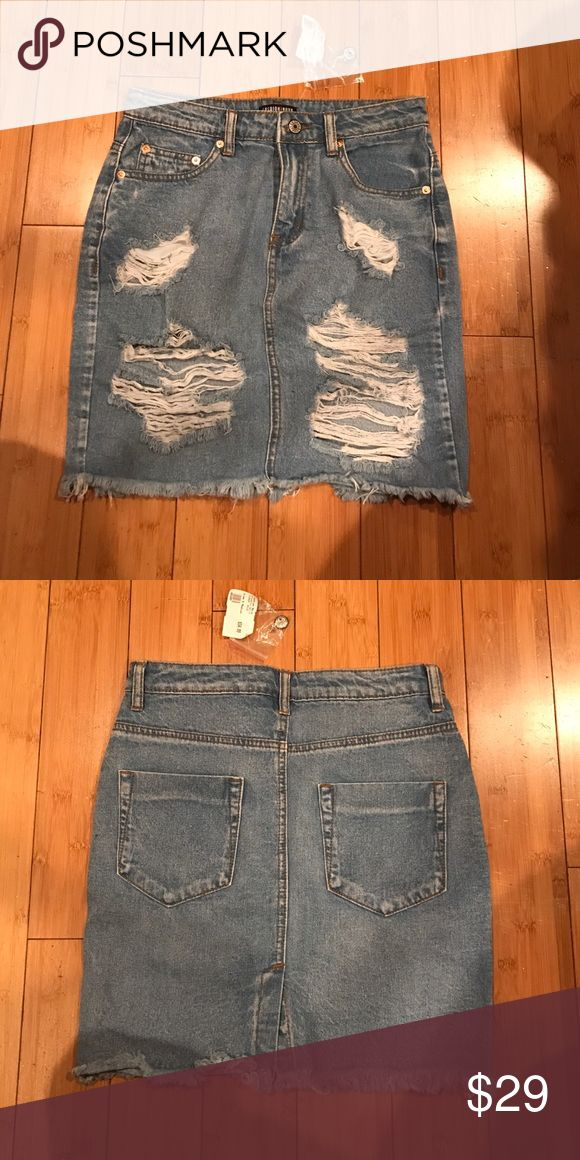 Distressed ripped denim jean skirt Brand new, never worn distressed denim skirt. Fashion Nova Skirts Mini