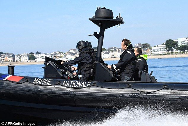 ON THE SEA LEVEL: French President Emmanuel Macron (C) sits on a boat of the French Navy, heading to the high seas emergency tow vessel 'Abeille Bourbon', near Lorient on June 1, 2017