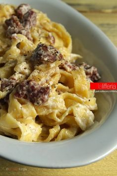 Tagliatelle con ricotta e salsiccia... Added olive oil and lemon juice. Delicious!: