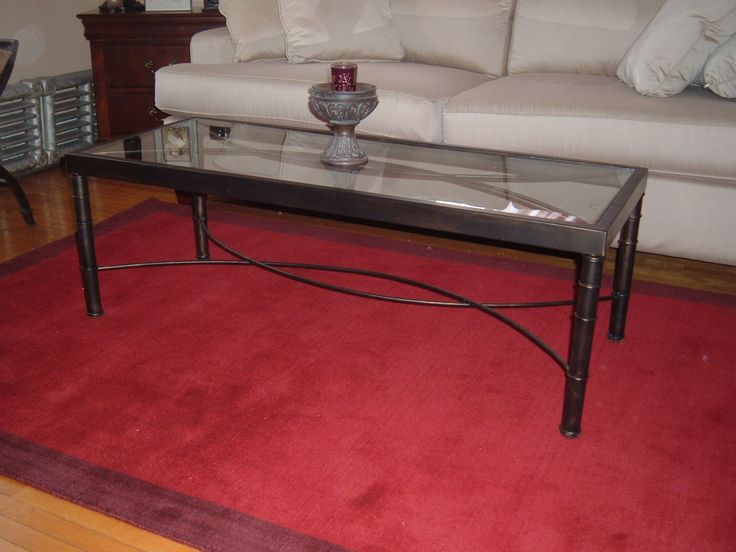 Wrought iron and glass coffee table. Custom work. Customer brought in a magazine image of original table she wanted reproduced.Photo taken inside customer's home. She was happy :)
