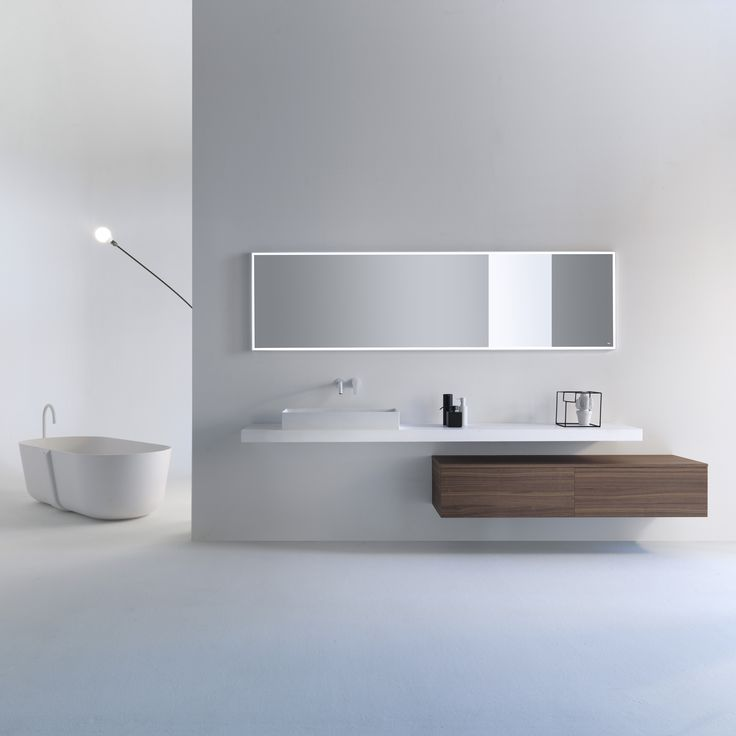 Essentiality can be tailored. VIAVENETO ELEMENTS composition consisting of self-supporting top in Cristalplant Biobased with rectangular washbasin, double-drawer base with Natural Walnut top and Cristalplant mirror with LED lighting. Discover more on www.falper.it