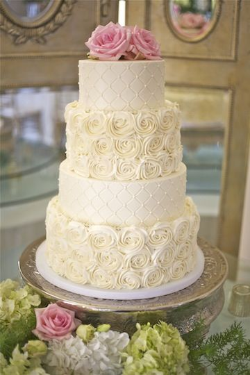 4 tier rosette cake. i think two or three would be plenty for us.