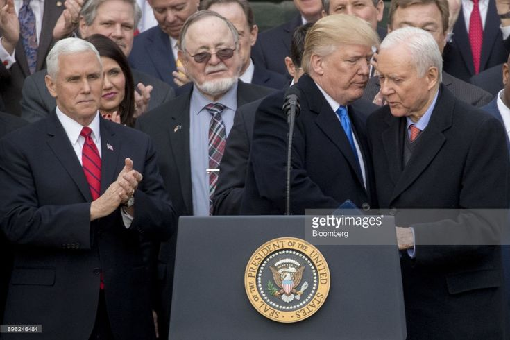 U.S. President Donald Trump, center, shakes hands with Senator Orrin Hatch, a Republican from Utah and chairman of the Senate Finance Committee, during a tax bill passage event with Republican congressional members of the House and Senate on the South Lawn of the White House in Washington, D.C., U.S., on Wednesday, Dec. 20, 2017. House Republicans passed the most extensive rewrite of the U.S. tax code in more than 30 years, hours after the Senate passed the legislation, handing Trump his…