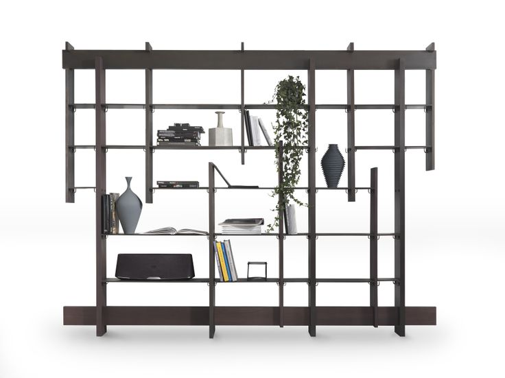 The shelves are made of metal sheet, coated by a sheet of finished brass oxidized with acid treatment, with the proper spaces to connect the sides.