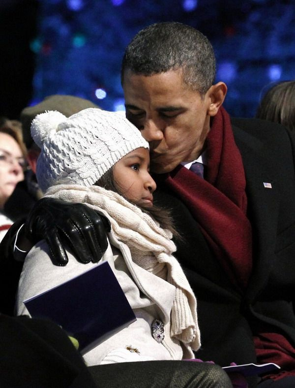 My President Barack Obama with Sasha at the Tree lighting ceremony at the White House.. .sweet.