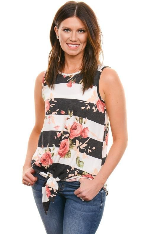 3bf2923a2d618 Multi-print tops are in! Rock it with a cardy or jacket over top. 92% Poly,  8% Spandex Color: Black/White Floral and striped print Front knot detail  Loose ...