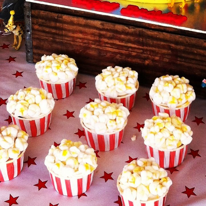 Popcorn cupcakes for a carnival themed 1st Birthday. I was surprised by how easy these were to make.