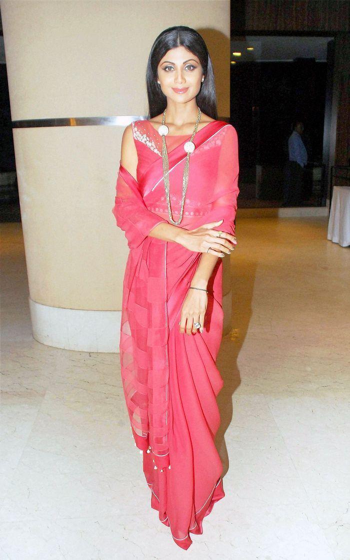 Shilpa Shetty wearing pink saree and statement necklace