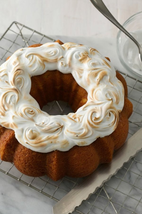 "Sweet potatoes and marshmallows are a match made in Thanksgiving heaven, and this oh-so-pretty Bundt cake is sure to get plenty of ""oohs"" and ""ahs."" Feel free to switch it up and use canned pumpkin in place of mashed sweet potatoes—and if you want to serve the marshmallow frosting toasted, you'll need to have a kitchen torch on hand."