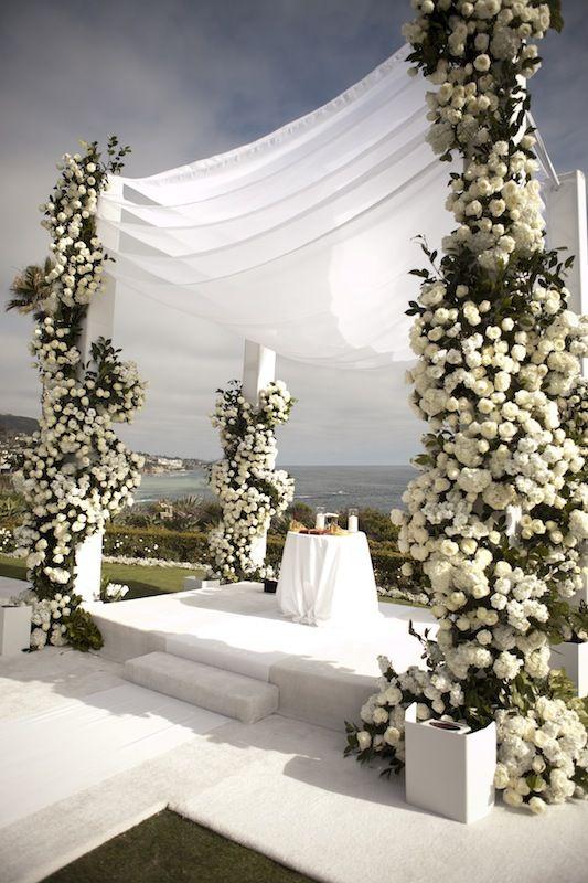 layered 7 blessings chuppah   Photograph by: Aaron Delesie     Venue: Montage Laguna Beach