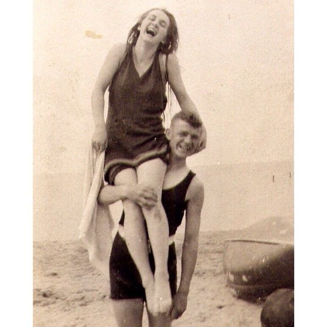 """This is my great-grandmother Borghild, """"Bobbie,"""" when she was about 16. She's laughing it up and being goofy on an unknown gentleman's shoulders at one of Chicago's beaches in the 1910's. Nana would sneak me and my brother into her room when we'd come over to my grandma's for dinner (Nana lived with my grandparents as she aged) and she'd always pull out a box of Fannie Mae candy and give us some right before dinner. At that time, she was just """"Nana"""" to me, but she was spunky as ever. I love…"""