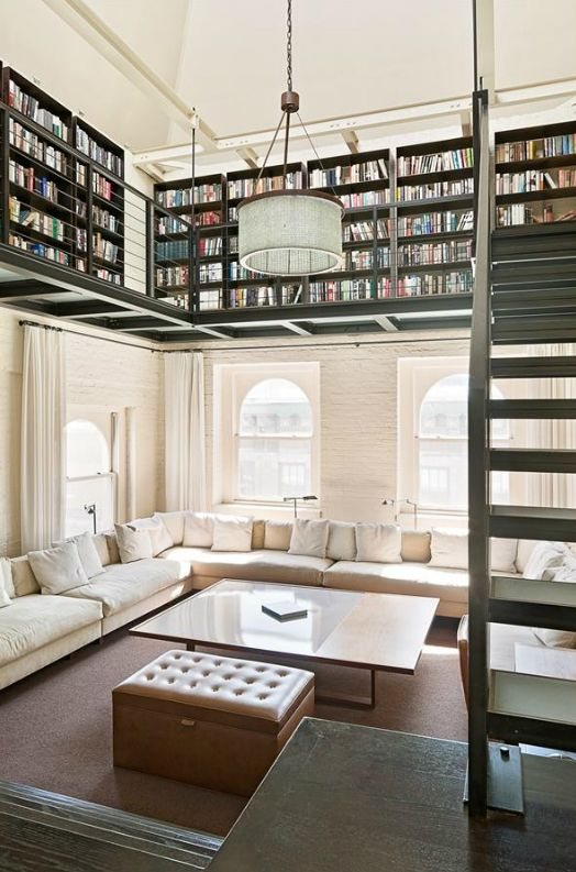 Not necessarily a nook, but a great place and idea for a home library - oh my gosh! I want this so bad!