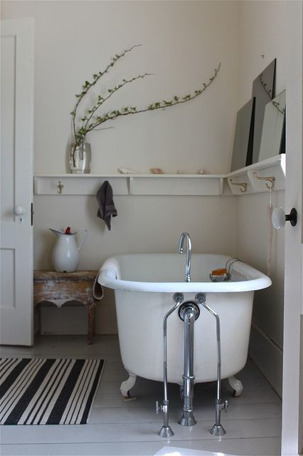 white and rustic bathroom. love that shelf around the bathroom. Great to hold hooks, leaning pictures, and bottles of girlie stuff for the bath.