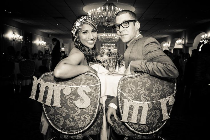 Sweetheart table with Mr and Mrs signs on seats Jenica+Josh Photo By Sherry Sutton Photography