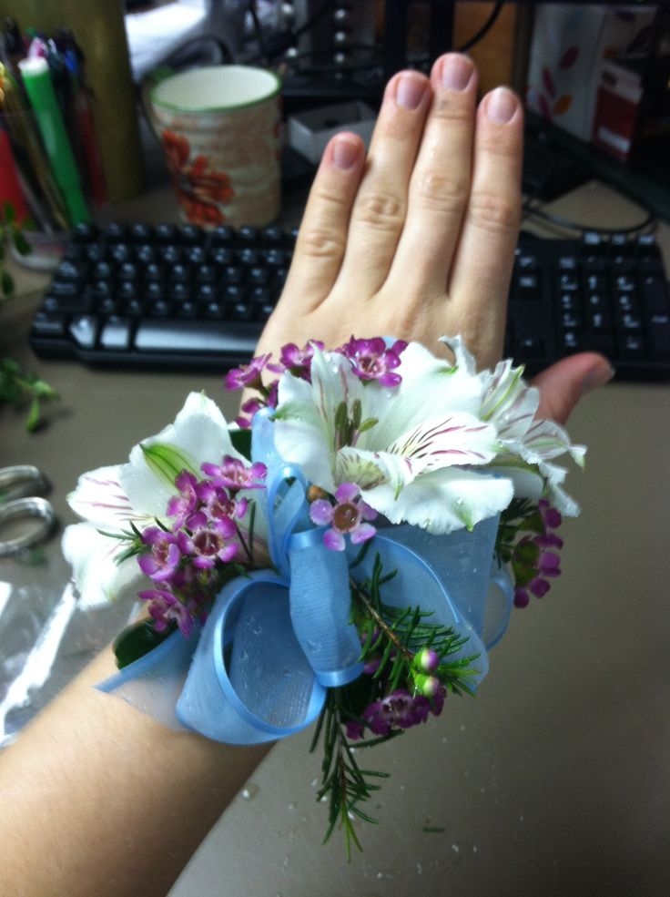Alstromeria, and wax flower wrist corsage (prom)