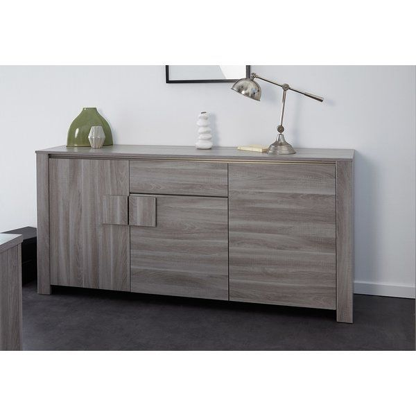Simple, elegant lines with designer-chic off-center cabinet handles make the Warren sideboard buffet interesting, and add an eclectic note for your decor.<br/>Three closed-door cabinets and one large roomy drawer add lots of storage room in your dining/living area.<br/>Parisot Company uses wood from Eco-managed forests, processes and packages with environmental consciousness, and is an accredited Green Way company.