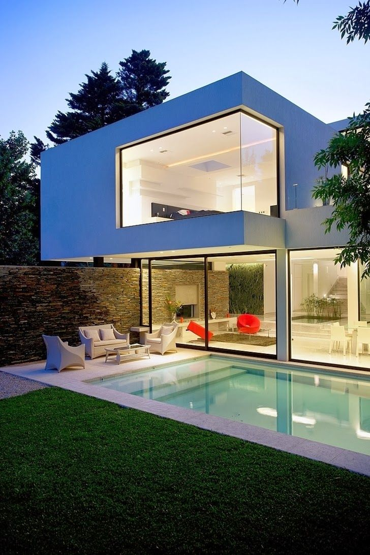 Facade lights on Minimalist Casa Carrara by Andres Remy Architects
