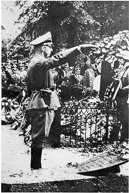 Heinrich Himmler  Reichsfuhrer-SS salutes Reinhard Heydrich's grave. Of note is the funeral pillow.Most officers in the second on the right Adolf Galland.