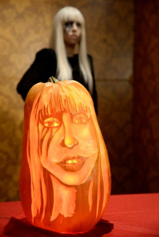Lady Gaga 'becomes' a Halloween pumpkin.