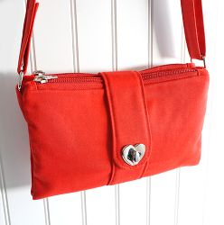 Butterfly Sling Purse cover. This site has all the hardware you'd need to make any purse. $