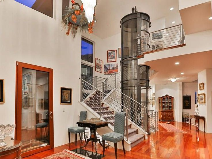 33 best images about core entry stairs library on for Luxury homes with elevators