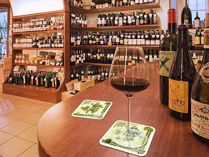 Podtácky s motivy starých odrůd vinné révy v interiéru vinotéky