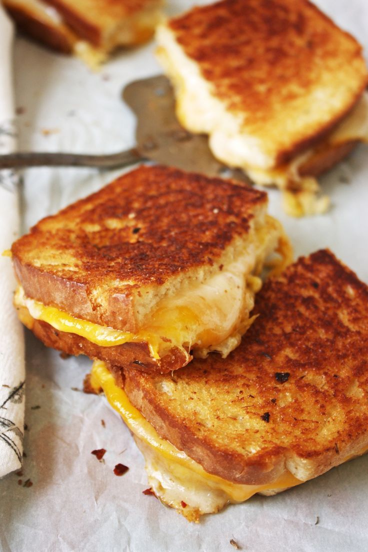 Fancy Schmancy Grilled Cheese Brushed with a garlic, red pepper flake, and thyme infused butter and stuffed with three different cheeses,
