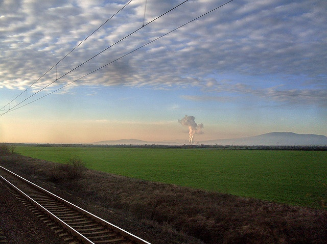 View from fast moving train. At the back ground: with smoke Power station and Mátra mountain . Mátra is a mountain range in northern Hungary, between to the towns Gyöngyös and Eger. The country's highest peak, Kékestető (1014 m), belongs to this moun Tips on how to (empower communications|video email|video presentation|video conference|your best internet video system|great biz opp) learn more on www.AV0409.iwowwe.com