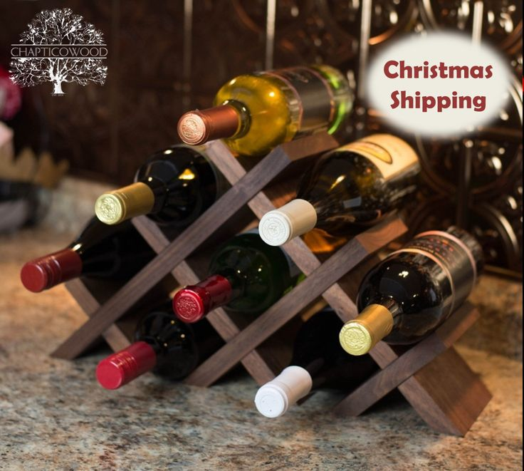 Tabletop Wine Rack in Solid Walnut - 8 & 13 Bottle Versions by ChapticoWood on Etsy https://www.etsy.com/listing/169794067/tabletop-wine-rack-in-solid-walnut-8-13