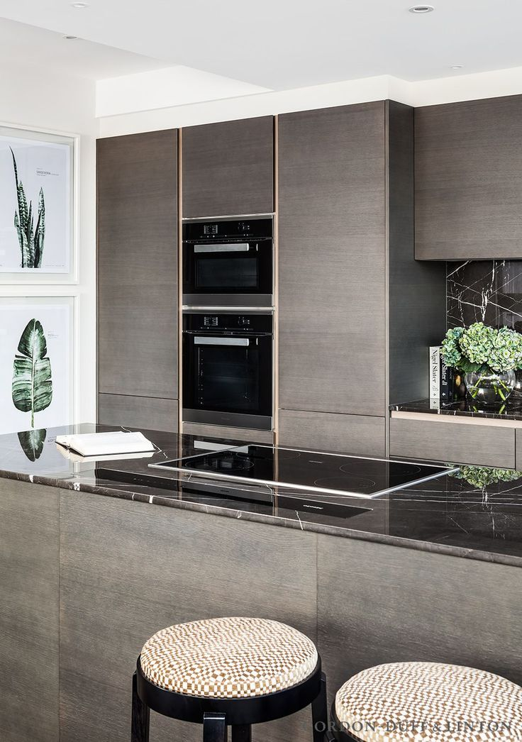 Italian Armony kitchen with worktop and splashback clad in grey marquina marble. Miele appliances. We covered the bar stools in a geometric velvet. #GD&LBespokeFurniture