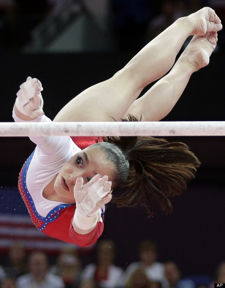 Russian gymnast Aliya Mustafina performs on the uneven bars during the artistic gymnastics women's apparatus finals at the 2012 Summer Olympics, Monday, Aug. 6, 2012, in London.